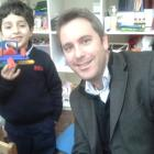 Mr Walton and FS2 pupil with his house in blocks