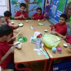 Year 2 Red decorating their cakes