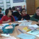 Mr. Clement solving Maths problems with Year 6